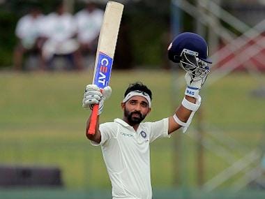 India's Ajinkya Rahane raises his bat and helmet to celebrate scoring a century during the second Test. AP