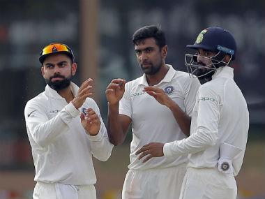 Ravichandran Ashwin celebrates the wicket of opening batsman Dimuth Karunaratne on Day 2. AP
