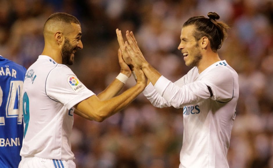 Real Madrid's Gareth Bale celebrates scoring their first goal with Karim Benzema. Reuters