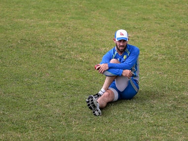 Australian's cricket player Glenn Maxwell stretches during a practice session in Dhaka. AP