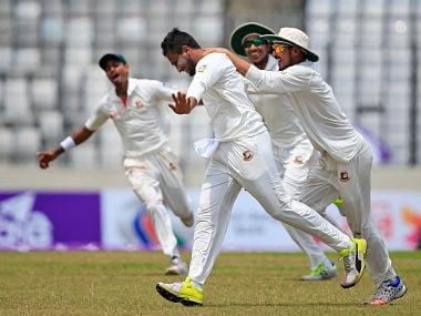 Bangladeshi teammates celebrate win over Australia in first Test match. AP