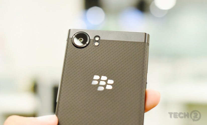 The glass camera lens, and BlackBerry logo.