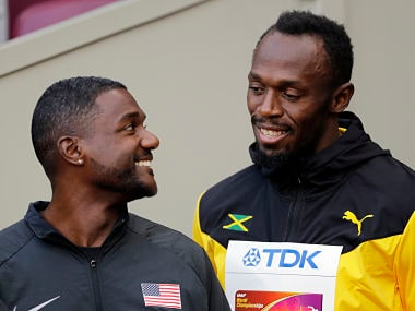 Justin Gatlin of the United States, gold, and Jamaica's Usain Bolt, bronze, from left, speak before the medal ceremony for the Men's 100m during the World Athletics Championships in London Sunday, Aug. 6, 2017. (AP Photo/David J. Phillip)