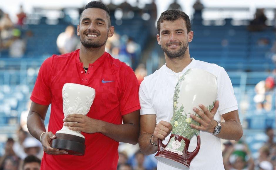 Grigor Dimitrov(R) holds the Cincinnati Masters trophyalongsiderunner-up Nick Kyrgios in the men's singles final. AP