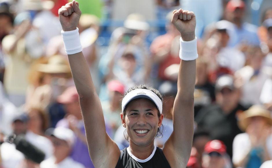 Garbine Muguruza cradled her smiling face in both hands and closed her eyes, taking it all in.Then she put her hands over her heart and reached toward the applauding crowd. AP