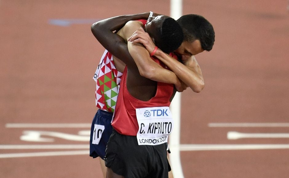 Conseslus Kipruto is embraced by Morocco 's Soufiane Elbakkali after winning the men's 3000 metres steeplechase final. Kipruto easily held off El Bakkali to win in 8 minutes, 14.12 seconds, .37 seconds ahead of the Moroccan. AP