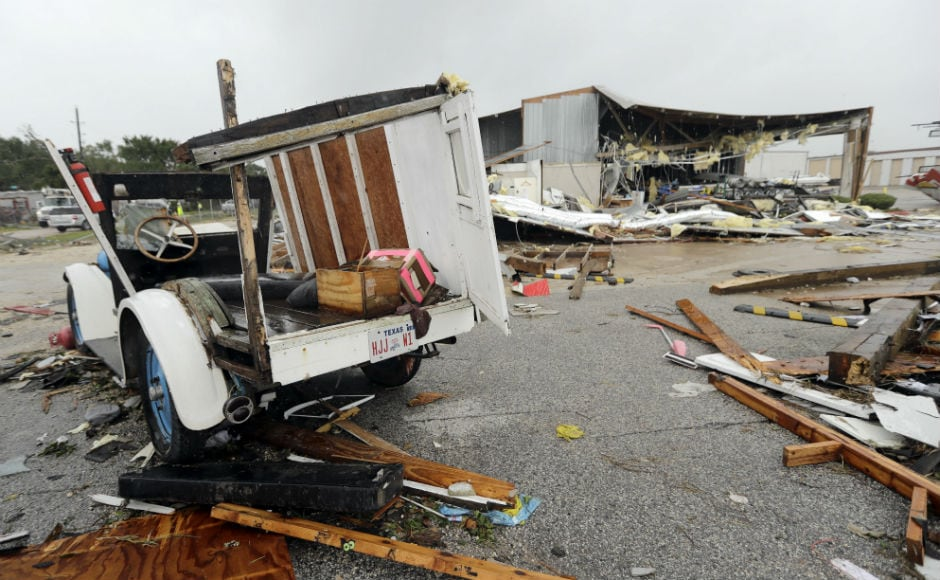 As stunned families surveyed the wreckage of destroyed homes and roads flooded or clogged with debris, Texas governor Greg Abbott has warned people to brace for a long recovery. AP