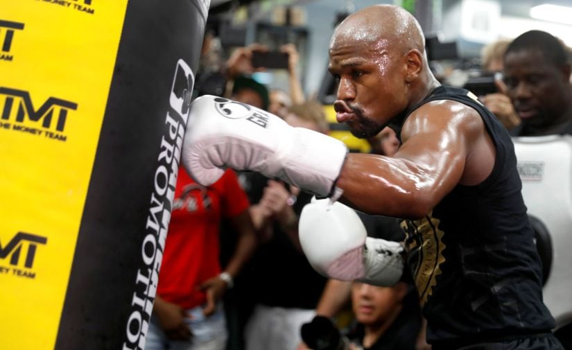 Floyd Mayweather hits a heavy bag during a workout at the Mayweather Boxing Club ahead of the super fight. Reuters