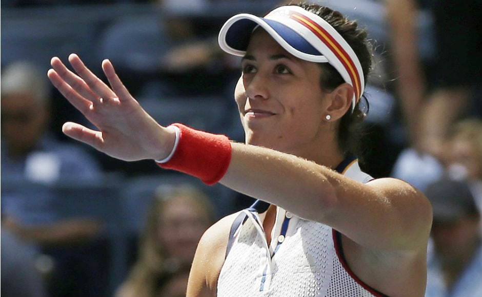 Wimbledon champion Garbine Muguruza advanced easily to the second round of the U.S. Open, needing just an hour to beat American Varvara Lepchenko 6-0, 6-3. AP