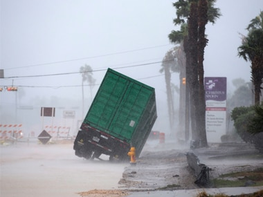 A truck tips over as winds