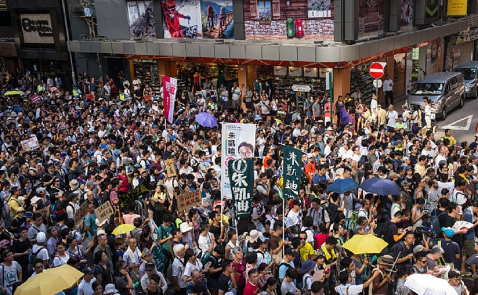 Demonstrators walked from Wan Chai district to the Court of Final Appeal, where the three activists are expected to lodge an appeal. Getty Images