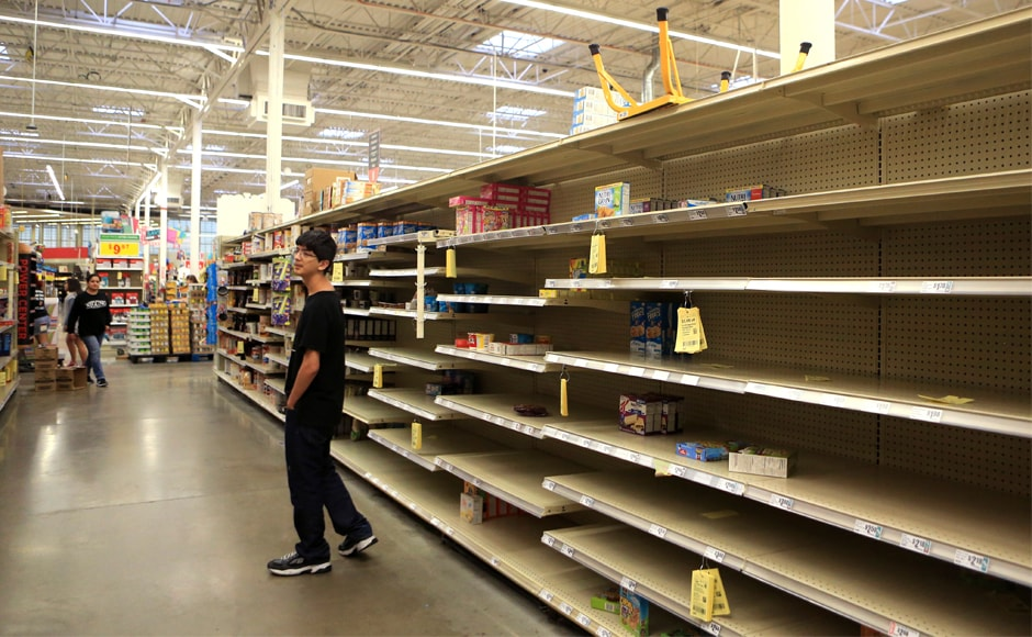 Supermarket aisles were stripped bare, as people boarded up supplies in their houses. Hurricane Harvey could dump up to 40 inches (more than one meter) of rain on the area over the next few days and cause billions of dollars in damage. AP