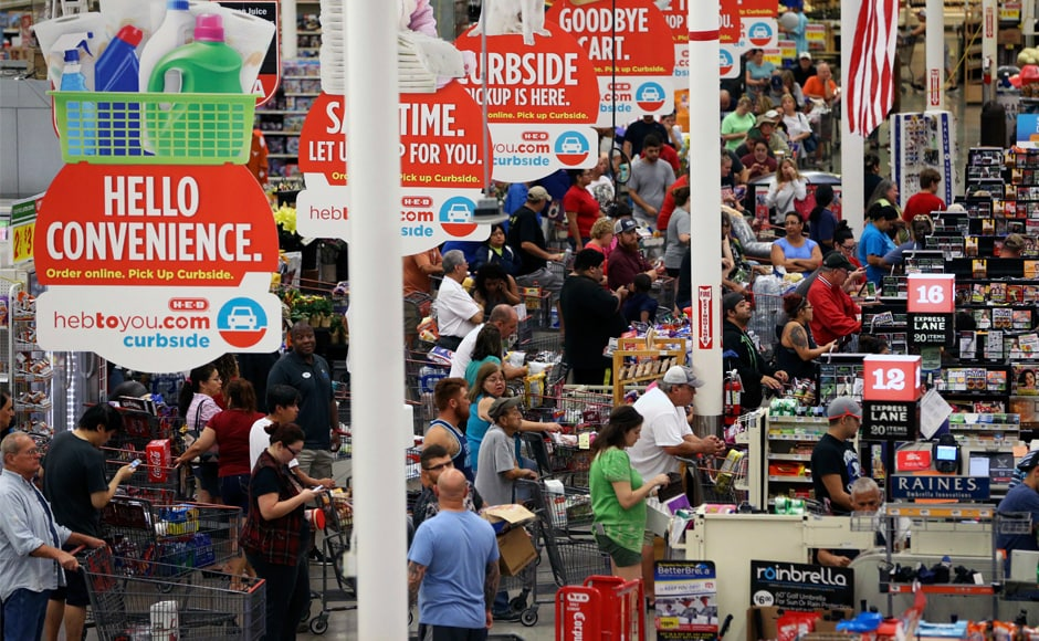 Shoppers stood in long queues for last-minute supplies at H-E-B Plus on Saratoga Boulevard just minutes before it closed and Hurricane Harvey hit the coast on Friday. AP