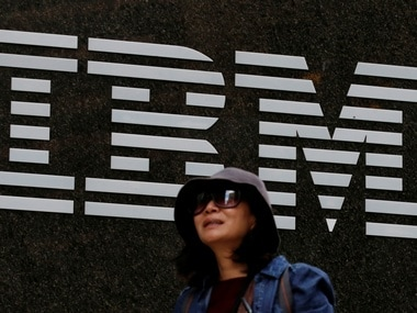 A woman passes by the IBM offices in New York. Image: Reuters