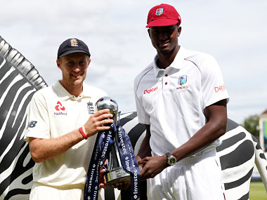 England's Joe Root and West Indies' Jason Holder pose with the trophy. Reuters