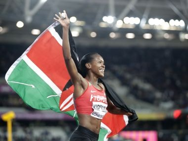 Kenya's Faith Chepngetich Kipyegon celebrates after winning the gold medal in the women's 1500-meter final during the World Athletics Championships in London Monday, Aug. 7, 2017. (AP Photo/Matt Dunham)