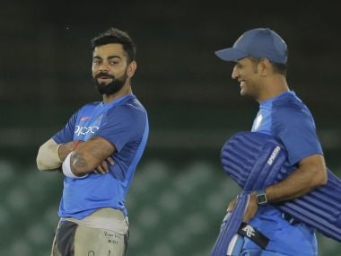 Indian cricket captain Virat Kohli, left, attends a practice session with teammate Mahendra Singh Dhoni ahead of their first one-day international cricket match against Sri Lanka in Dambulla, Sri Lanka, Saturday, Aug. 19, 2017. (AP Photo/Eranga Jayawardena)