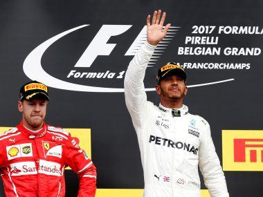 Formula One - F1 - Belgian Grand Prix - Spa-Francorchamps, Belgium - August 27, 2017 Mercedes' Lewis Hamilton celebrates on the podium after winning the 2017 Belgian Grand Prix alongside second-placed Ferrari driver Sebastian Vettel REUTERS/Francois Lenoir TPX IMAGES OF THE DAY - RTX3DJ61