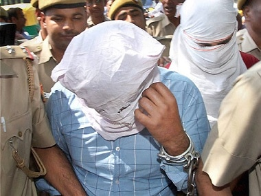 The accused being produced in Patiala House court in New Delhi in connection with murder of BSP leader Deepak Bhardwaj. PTI