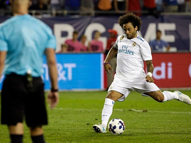 Real Madrid's Marcelo score the decisive penalty against the MLS All-Stars. AP