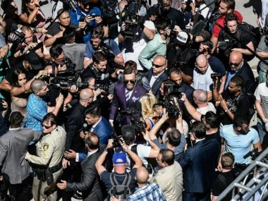 Conor McGregor surrounded by cameras on media day. Image Courtesy: Twitter @TheNotoriousMMA
