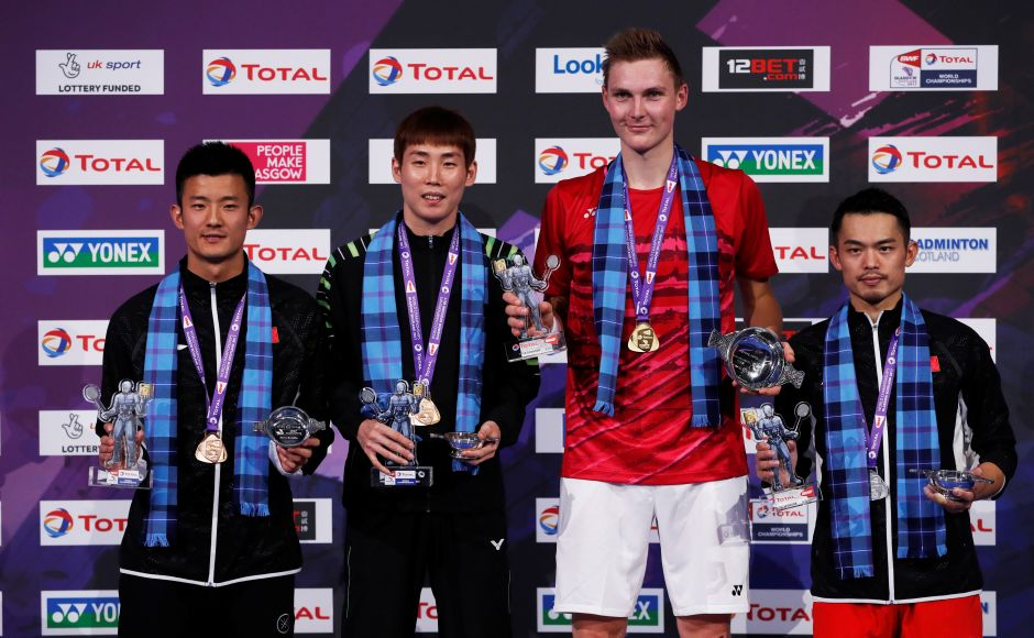 Denmark's Viktor Axelsen (2nd from right)  held his nerve to win his first World Badminton Championships at the expense of his idol, the great Lin Dan (R) on Sunday. Reuters