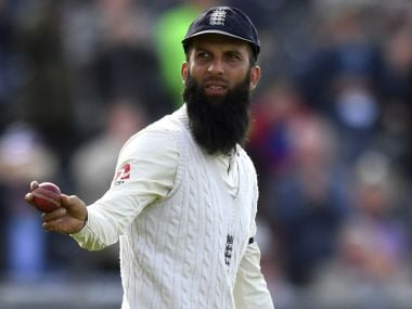 England's Moeen Ali walks off the pitch with the ball and a stump, as England celebrate winning the test match against South Africa during day four of the Fourth Test at Emirates Old Trafford in Manchester, England, Monday Aug. 7, 2017. (Anthony Devlin/PA via AP)