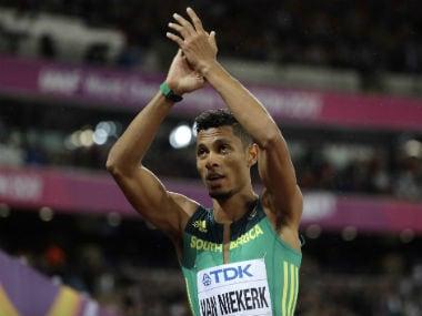 South Africa's Wayde van Niekerk applauds after qualifying for the final of men's 200m in London. AP