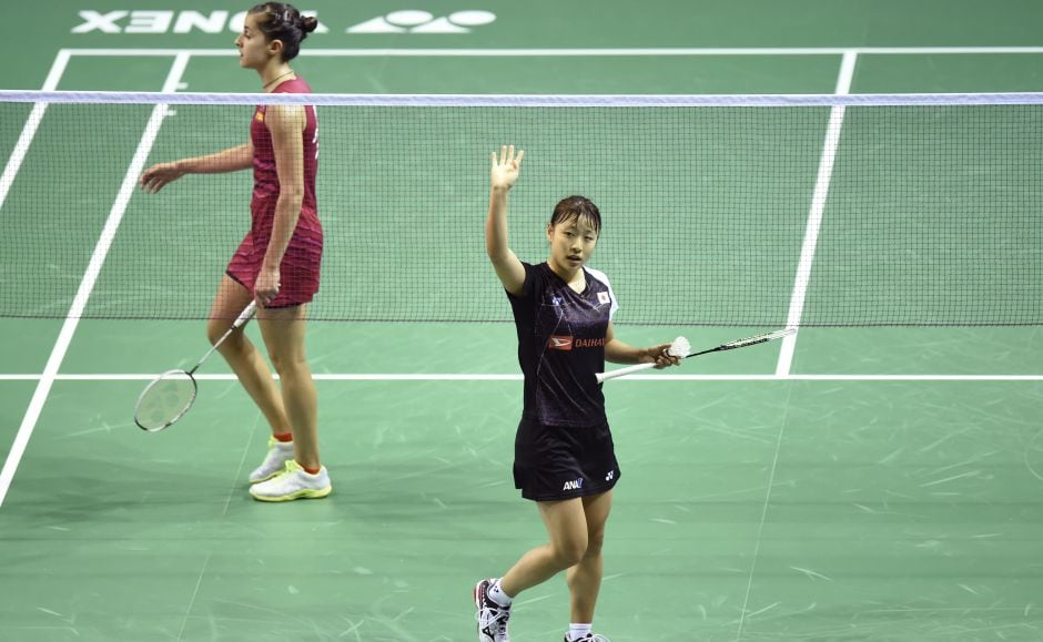 Rio Olympic gold medallist Carolina Marin's reign came to a surprise end following a 19-21, 21-14, 15-21 defeat to Japan's Nozomi Okuhara (R). Okuhara faces Saina Nehwal in the semi-final. AFP