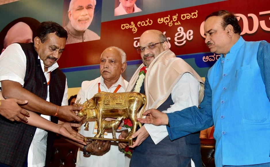 Amit Shah was presented a memento by state BJP president BS Yeduyurappa and Union minister Ananth Kumar during an intellectual meet in Bengaluru on Saturday. PTI