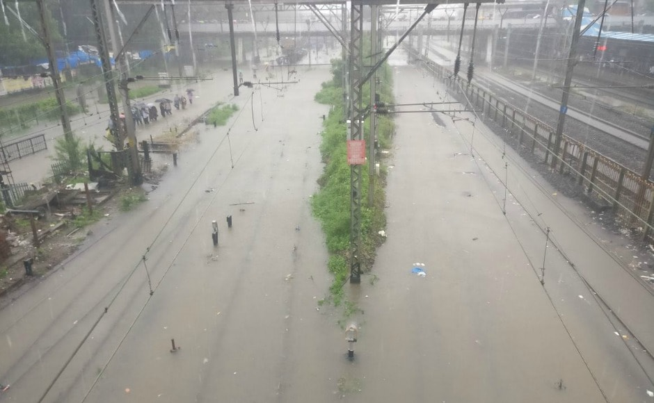 Transport services have been affected heavily by the rains as flights are experiencing a long delays. Suburban railway too is experiencing heavy delays with many trains even being cancelled. Firstpost/Anshul Vipat