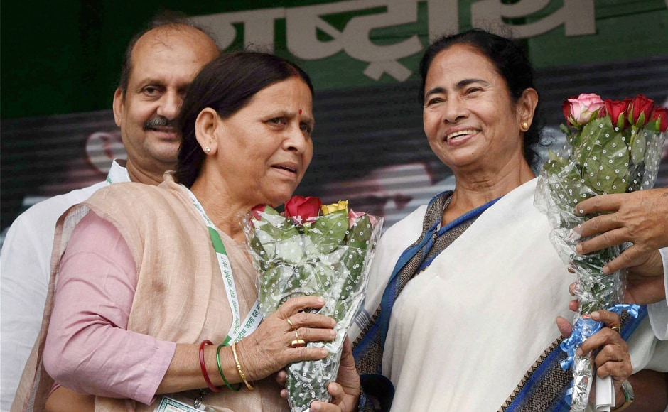 RJD senior leader Rabri Devi greets Mamata Banerjee at the rally. Banerjee on Sunday targeted the BJP and Prime Minister Narendra Modi for making