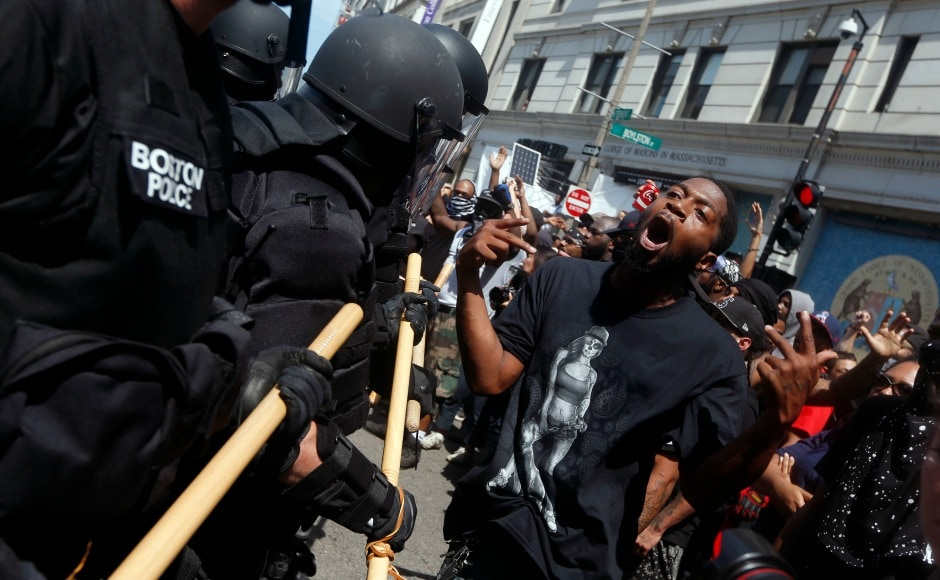 The Boston Police Department arrested thirty-three people, largely for scuffles in which some protesters threw rocks and bottles of urine at police dressed in riot gear. AP
