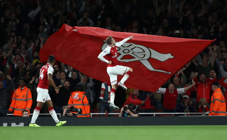 Arsenal's Aaron Ramsey equalised with a shot from close range seven minutes from time with Mesut Ozil appearing to handle the ball in the build-up. Ramsey pictured celebrating scoring their third goal. Reuters