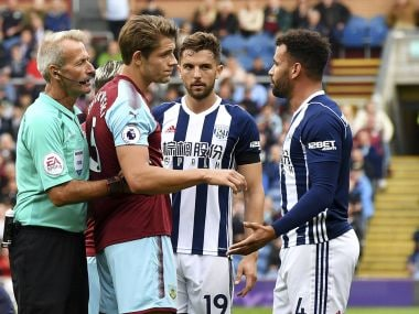 West Bromwich Albion's Hal Robson-Kanu (right) is shown a red car for a challenge on Burnley's Matthew Lowton, during the English Premier League soccer match between Burnley and West Bromwich Albion, at Turf Moor, in Burnley, England, Saturday Aug. 19, 2017. (Anthony Devlin/PA via AP)