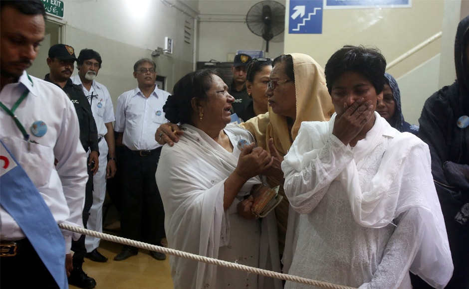 Colleagues mourn next to the casket of Ruth Pfau. In collaboration with the government, Pfau expanded leprosy treatment centres in more than 150 cities and towns across Pakistan, training doctors, treating thousands of victims and helping establish a national programme to bring the disease under control.AP