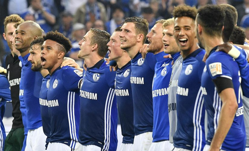 Schalke's team celebrates with supporters after the German Bundesliga soccer match between FC Schalke 04 and RB Leipzig at the Arena in Gelsenkirchen, Germany, Saturday Aug. 19, 2017. Schalke defeated Leipzig with 2-0. (AP Photo/Martin Meissner)