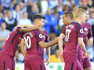 Manchester City's Sergio Aguero, centre, celebrates scoring his side's first goal. AP