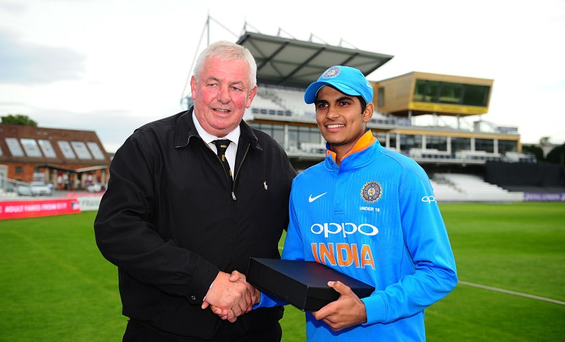 Shubman Gill of India U19s (R) is presented with the India player of the tournament award by David Graveney during the 5th Youth ODI match between England U19s and India Under 19s. Getty