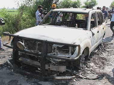 The burnt remains of a car torched by unknown people at Kotli village in Sirsa on Monday. PTI