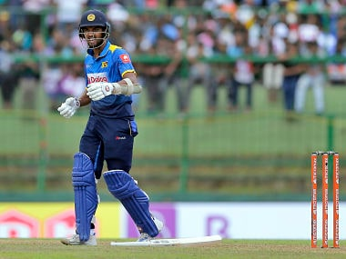 Dinesh Chandimal grimaces in pain after he was hit by a delivery by Hardik Pandya