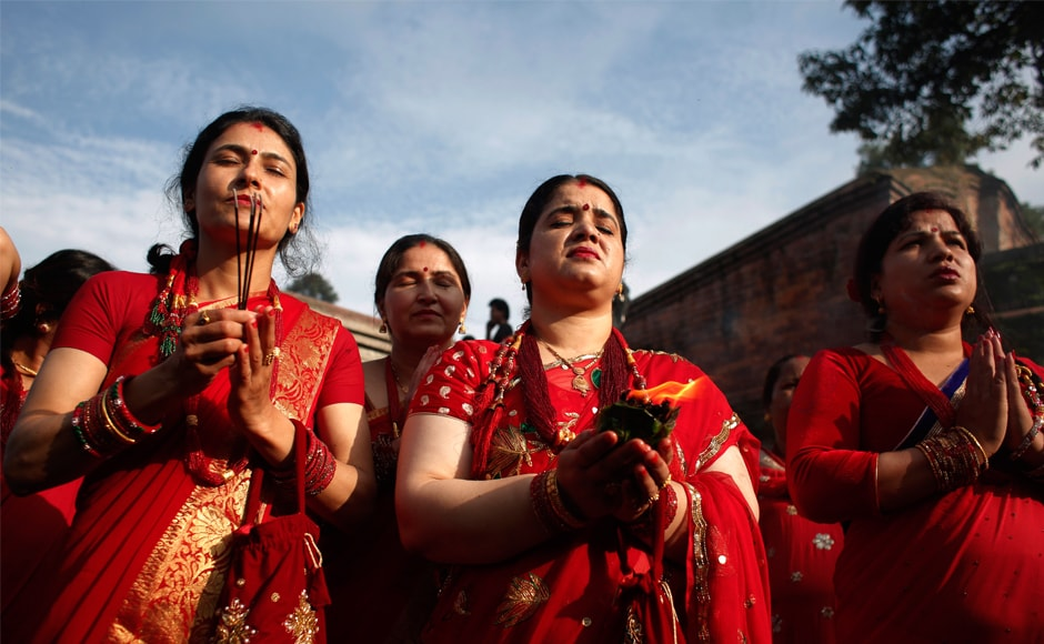 Hindu women offer prayers at the Pashupatinath temple during Teej festival celebrations in Kathmandu, Nepal. During Teej, Hindu women observe a day-long fast and pray for their husbands and for a happy married life. Those who are unmarried pray for a good husband. AP