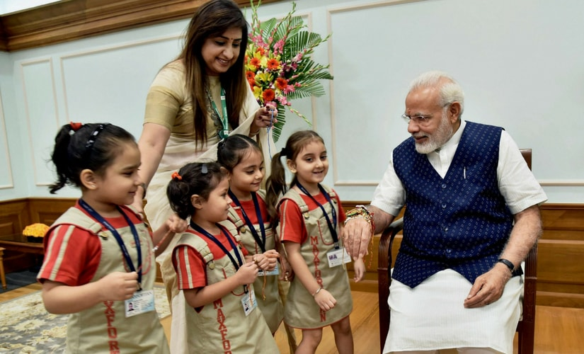 Women and children from various segments of society on Monday called on Prime Minister Narendra Modi at his official residence and tied 'rakhi' on his wrist on the occasion of Raksha Bandhan. PTI