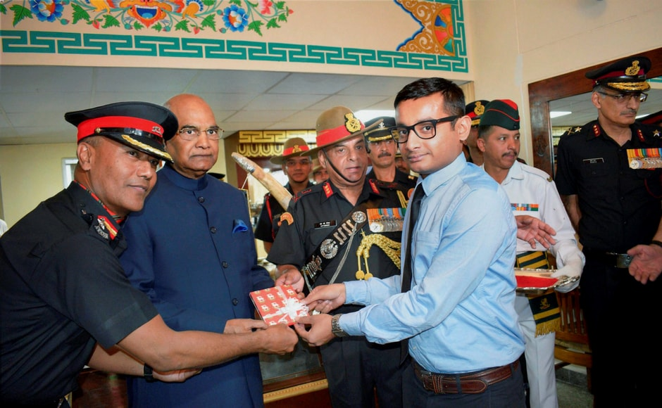 President Ram Nath Kovind confers the President's Colours to the Ladakh Scouts Regimental Centre and all five battalions of the Regiment, at Leh in Ladakh on Monday. PTI