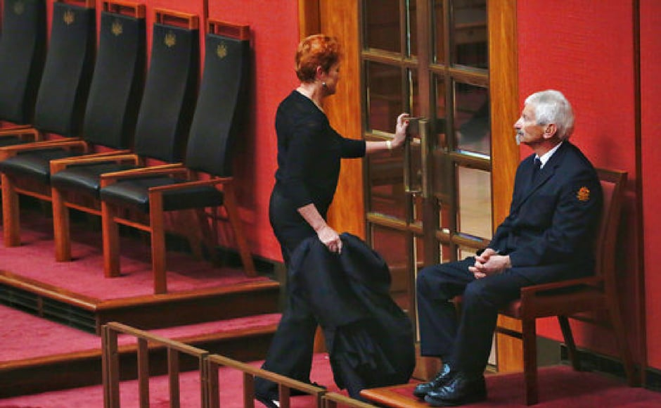 Senator Pauline Hanson, left, leaves carrying the burqa she wore in the Senate chamber on Thursday. Parliament House briefly segregated women wearing burqas and niqabs in 2014. The department that runs Parliament House said that