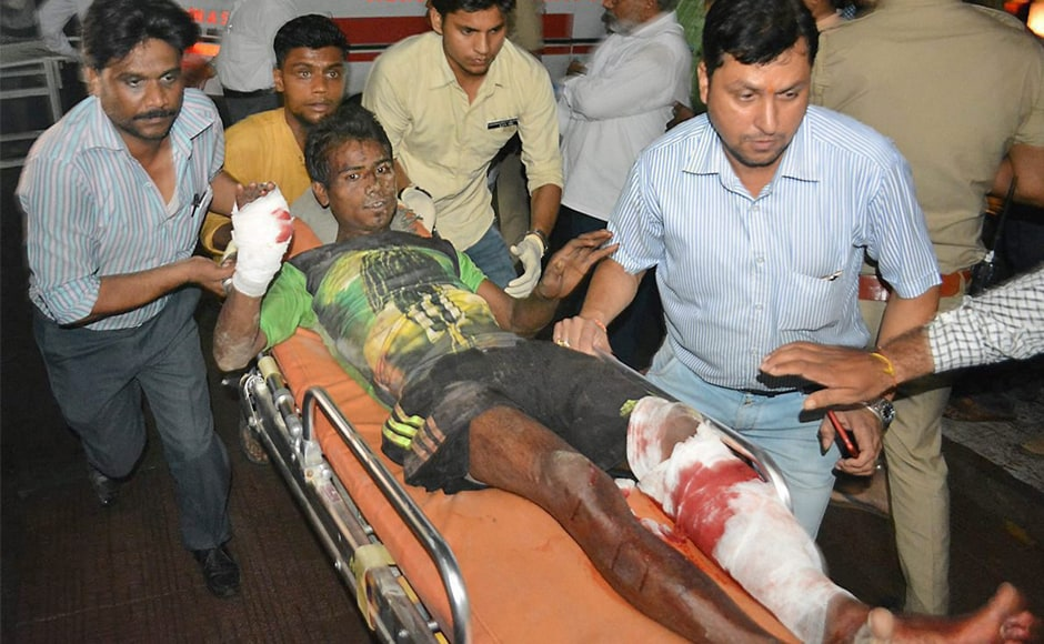 A victim is being taken away for treatment from the accident site where coaches of the Puri-Haridwar Utkal Express train were derailedon Saturday. Rescue operations were conducted through the night and concluded on Sunday morning. PTI
