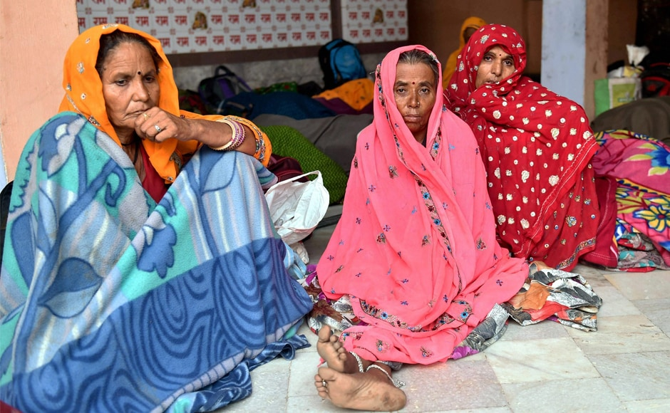 Survivor of the Utkal Express accident sit at a temple after the derailment in Khatauli on Sunday. Officials are investigating an unverified audio clip where two railway employees allegedly spoke about poor maintenance and patrolling as the cause of the accident. PTI