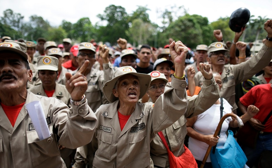 Venezuelan troops taught civilians how to use their fists, rifles, bazookas and anti-aircraft guns at the Caracas military academy on 26 August. AP
