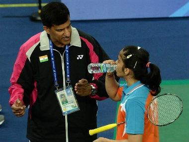 File image of Vimal Kumar and Saina Nehwal. AFP