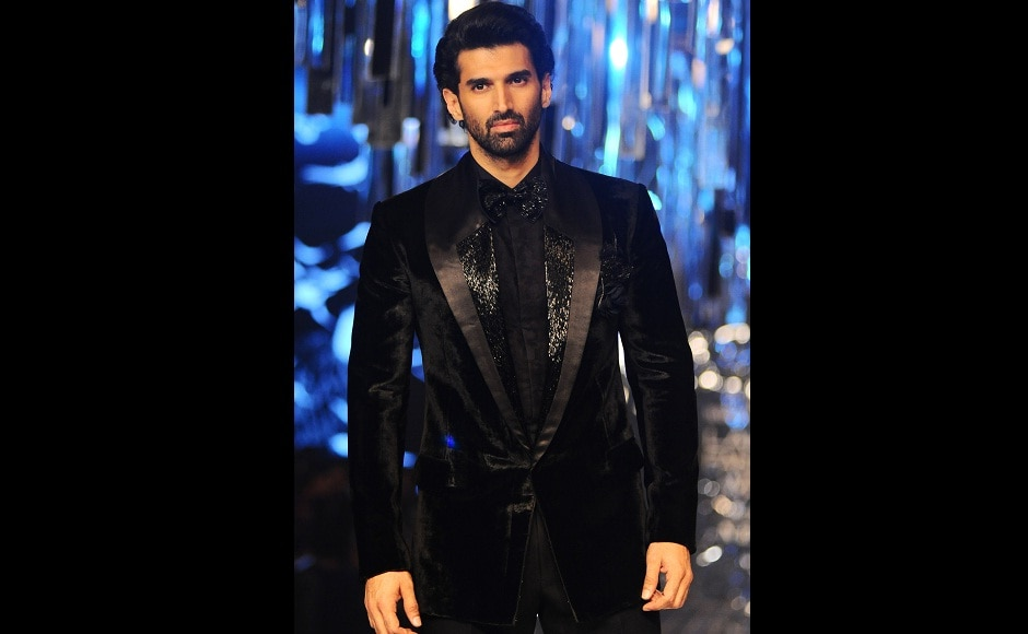 Aditya Roy Kapur wore a bespoke suit and closed Manish Malhotra's show along with Fernandez. Image from AFP.